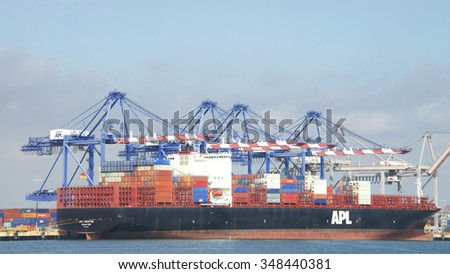 SAN PEDRO, CA - NOVEMBER 24, 2015: Cargo Ship APL HOUSTON loading at the Port of Los Angeles. The Port of Los Angeles  occupies 7,500 acres of land and water along 43 miles of waterfront. - stock photo