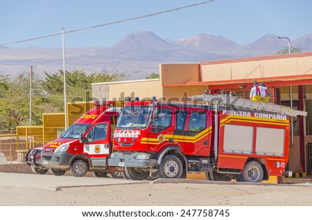 SAN PEDRO DE ATACAMA, CHILE, MAY 18, 2014: Fire trucks park in front of fire station  - stock photo