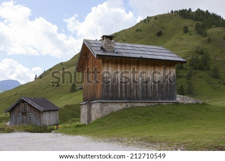 San Pellegrino Pass, Fulciade, Italy a Typical mountain hut, typical historical mountain house. - stock photo