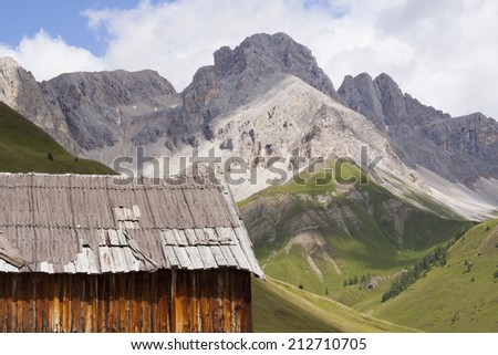 San Pellegrino Pass, Fulciade, Italy a Typical mountain hut, typical historical mountain house - stock photo