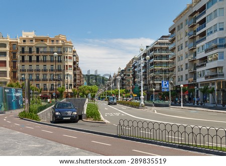 SAN SEBASTIAN or DONOSTIA, SPAIN-JUN 14: San Sebastian or Donostia is a coastal city and located on the coast of the Bay of Biscay, Spain.View to the promenadeand city on 14 Jun, 2015, Spain. - stock photo