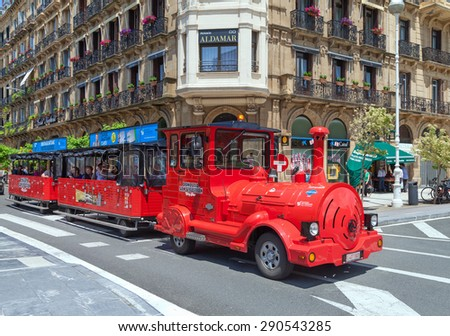 SAN SEBASTIAN or DONOSTIA, SPAIN-JUN 14: San Sebastian or Donostia is a coastal city and located on the coast of the Bay of Biscay, Spain. Touristic train on the street on 14 Jun, 2015, Spain. - stock photo