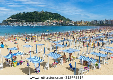 SAN SEBASTIAN, SPAIN - AUG 27: La Concha beach in a sunny day on August 27, 2015 in San Sebastian, Spain. - stock photo