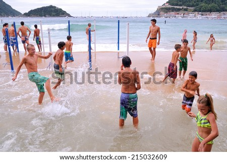 SAN SEBASTIAN, SPAIN - AUG 11: People have fun at the Donostia La Concha beach, at the Basque Festival on August 11, 2014 in San Sebastian, Spain.