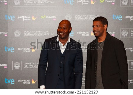 SAN SEBASTIAN - SPAIN - SEPTEMBER 24: Denzel Washington and Antoine Fuqua before the press conference of The Equalizer film in the film festival of San Sebatian 2014 on September 2014 - stock photo
