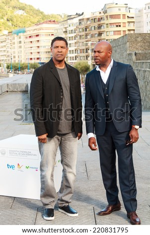 SAN SEBASTIAN - SPAIN - SEPTEMBER 24: Denzel Washington and Antoine Fuqua greet reporters before the press conference of The Equalizer film in the film festival of San Sebatian 2014 on September 2014 - stock photo