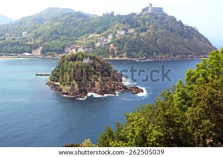 San Sebastian. Spain. View of the island Santa Klara, located in the center of the Gulf of La Concha. - stock photo