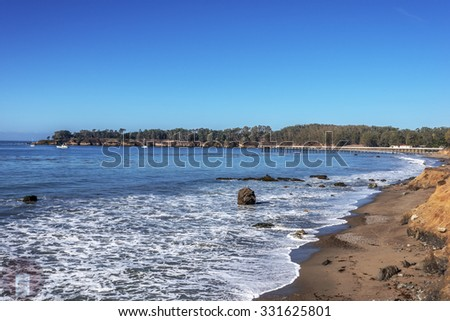 San Simeon Bay, Pier & W R Hearst Memorial State Beach, blue sea and sky, three boats anchored in the cove, located on the rugged Big Sur coastline, near Cambria, CA. on the California Central Coast. - stock photo