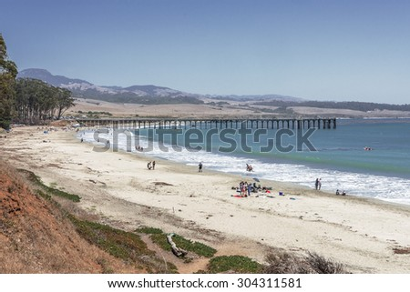 San Simeon Bay, Pier & W R Hearst Memorial State Beach, people on the beach, located on the rugged Big Sur coastline, near Cambria, CA. on the California Central Coast. - stock photo