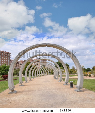 SAN VICENTE DEL RASPEIG, ALICANTE, SPAIN - JUN 9:  Footpath with cement arches adds an artistic touch to the walk in Park Lo Torrent a city public park in San Vicente Del Raspeig. June 9, 2013.
