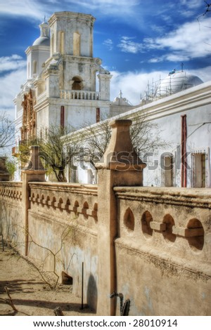 San Xavier del Bac Mission, Tucson, Arizona. Great for travel, adventure, religion, tourism, outdoor recreation themes. HDR composite image with light softening and toning FX for a nice glow. - stock photo