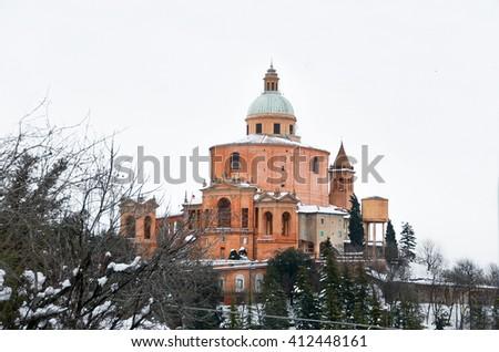 sanctuary isolated white background San Luca Bologna Emilia Romagna region Italy snow winter church - stock photo