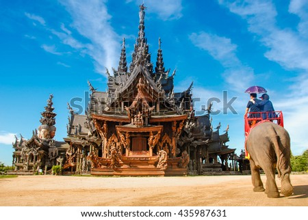 Sanctuary of Truth, Pattaya.Sanctuary of Truth, is a temple construction in Pattaya, Thailand. It is an all-wood building filled with sculptures based on traditional Buddhist and Hindu motifs. - stock photo