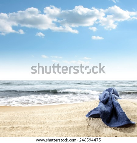 sand and blue towel and sky  - stock photo