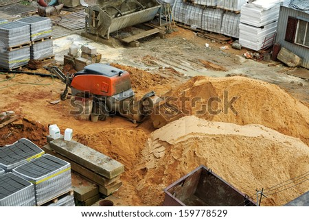 Sand and cement mixer at a construction site.