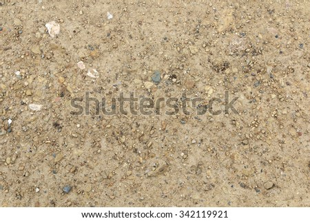 Sand and dusty surface with small stones background - stock photo