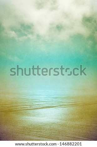 Sand and flowing ocean water disappearing into the horizon with swirling fog above.  Image displays a pleasing grain pattern at 100 percent. - stock photo