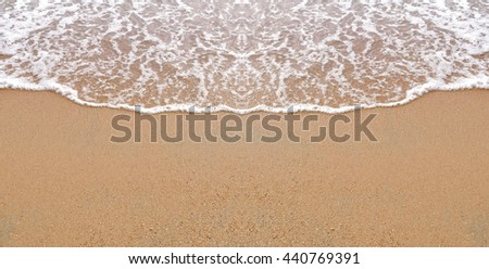 Sand and sea on the beach. Abstract natural background for travel and summer. - stock photo