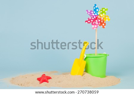 Sand and toys at the beach - stock photo
