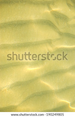 Sand and water There are sand waves in the water.  - stock photo