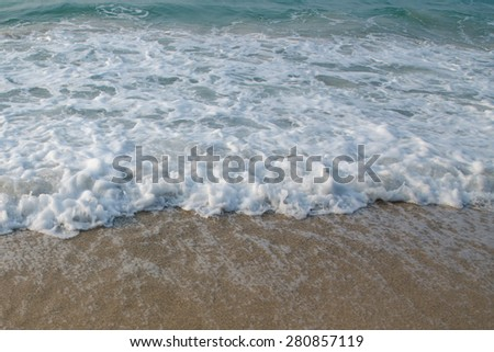 sand and wave on beach