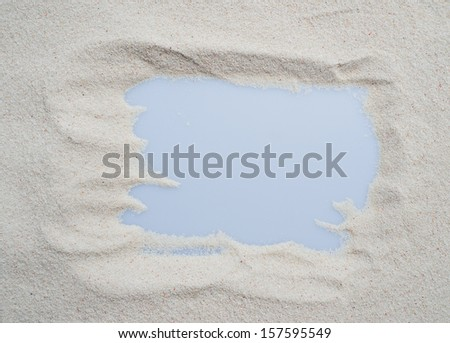 sand background with frame pattern. - stock photo
