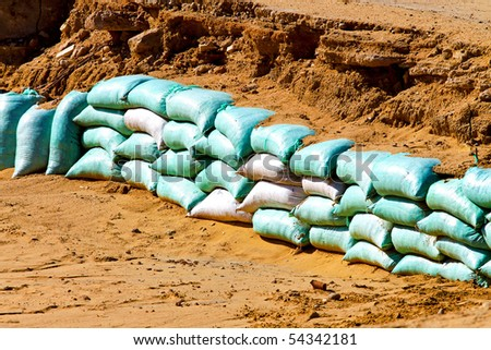 Sand bags barrier for water flood protection - stock photo