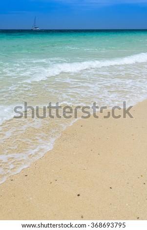 SAND BEACH AND BLUE SEA - tropical sea, thailand - stock photo