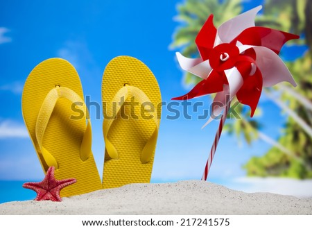 Sand beach and flip flops - stock photo