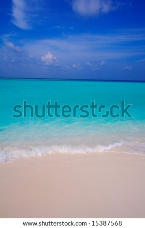 Sand beach and ocean wave, Ari-Atoll. Maldives