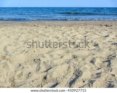 Sand beach and sea. Sunny day light - stock photo