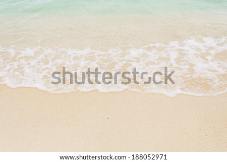 Sand beach and wave. - stock photo