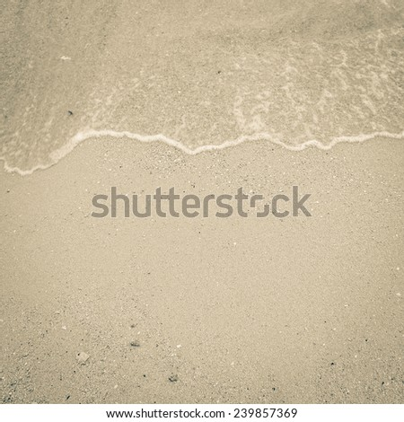 sand beach and wave  with vintage color tone and vignette for background