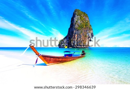 Sand beach on sea coast of tropical island in Thailand at sunny summer day with blue sky and clear water. Holiday vacation background  - stock photo