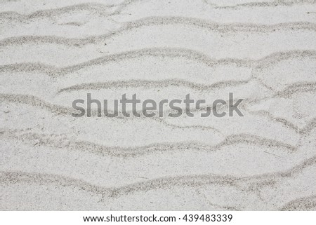Sand beach texture wave pattern background,close up,select focus with shallow depth of field - stock photo