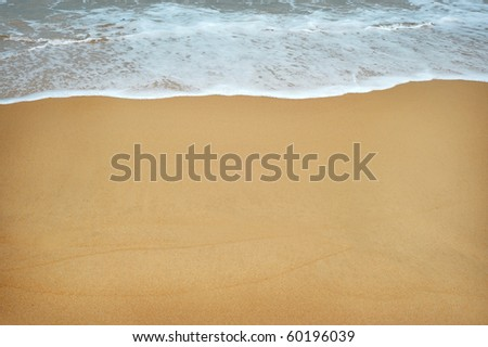 Sand beach water background - stock photo