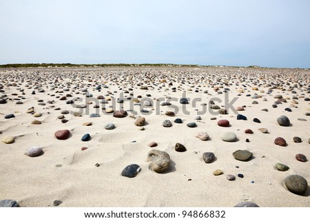 Sand beach with small stones - stock photo