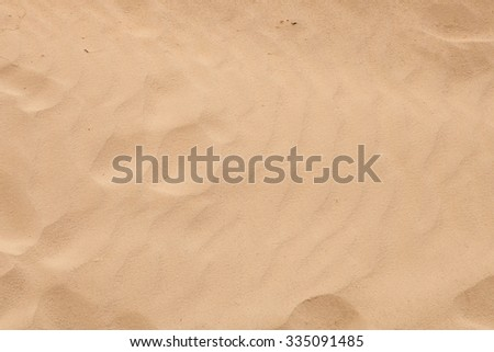 Sand beach with waves formed by the air - stock photo