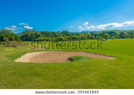 Sand bunker at the golf course. - stock photo