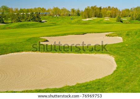 Sand bunker on the golf course. - stock photo