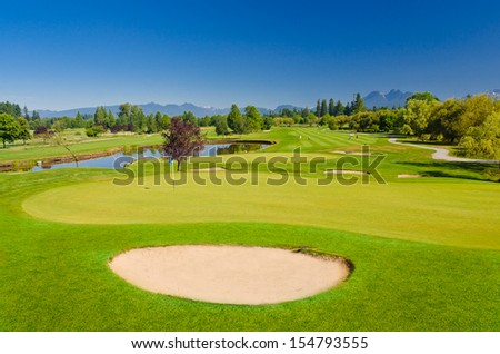 Sand bunkers on a beautiful golf course with the mountains at the back. Canada, Vancouver.