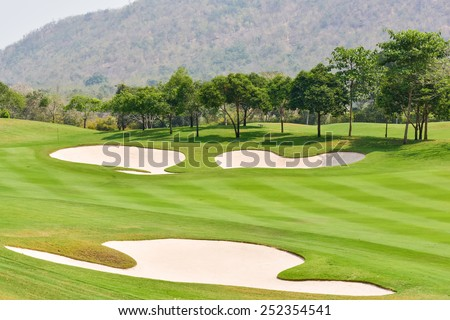 Sand bunkers on the golf course - stock photo