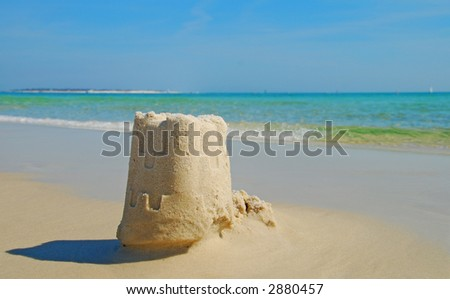 Sand Castle and Shadow - stock photo