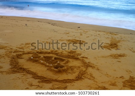 Sand castle and waves on golden beach of Tasman National Park, south Island, New Zealand - stock photo