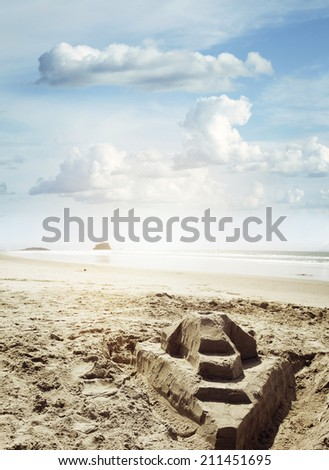 Sand castle at the beach - stock photo