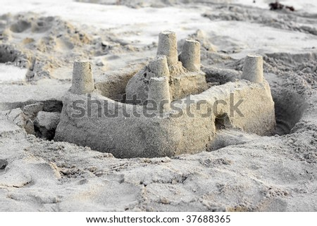 Sand castle in a beach - stock photo