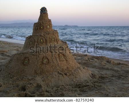 Sand castle near the sea - stock photo