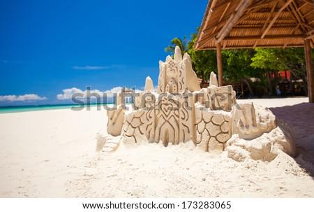 Sand castle on a white tropical beach in Boracay - stock photo