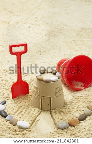 Sand castle on beach elevated view - stock photo