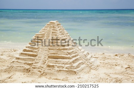 Sand Castle on Beach. Mayan pyramid from sand.  - stock photo